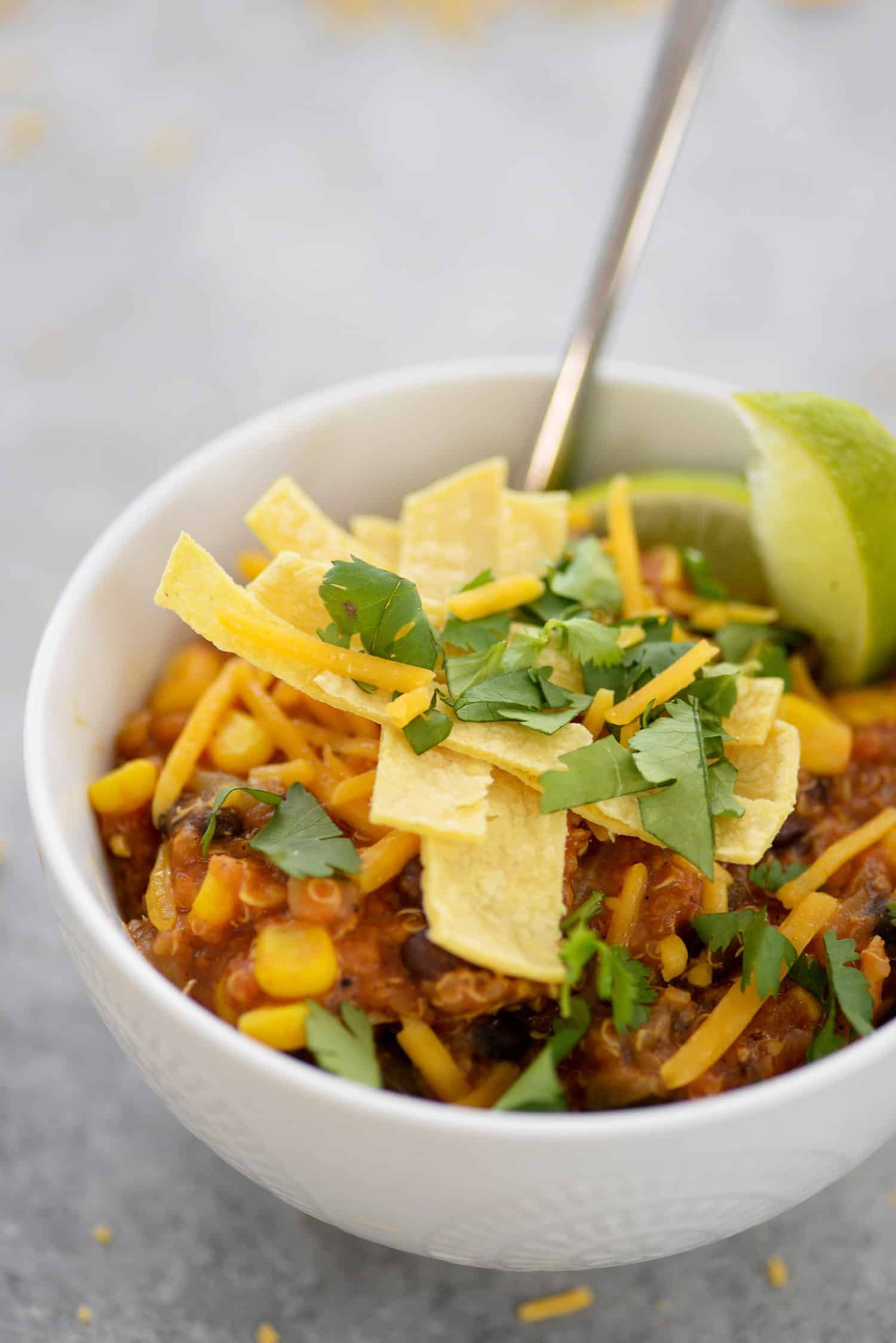 Instant Pot Enchilada Casserole. Yummy, vegetarian and gluten-free! Cooked quinoa, beans, corn and