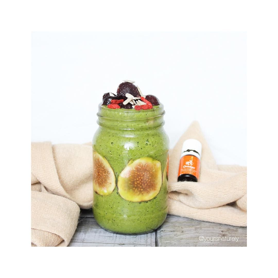 Loving the green smoothie and Orange oil combo. Only with Young Living of course! Topped with dark sweet cherries, sunflower seeds and gojis with some slices of figs to complement
