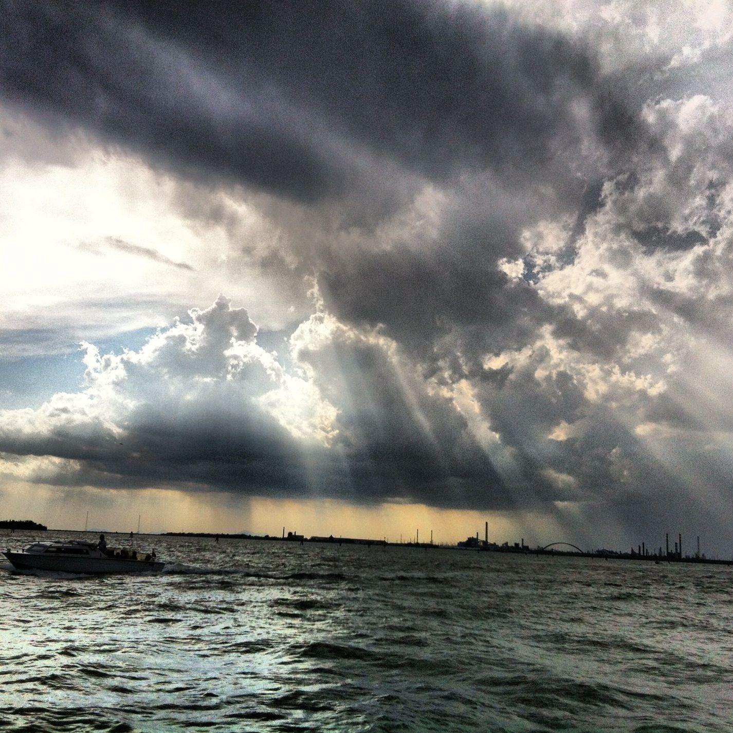 Sunbeams breaking through the dark clouds in Venice.