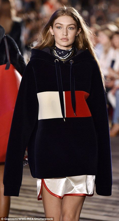 986a6d8a4 Earning her fashion stripes  The model strutted her stuff in a velvet Tommy  Hilfiger logo sweatshirt