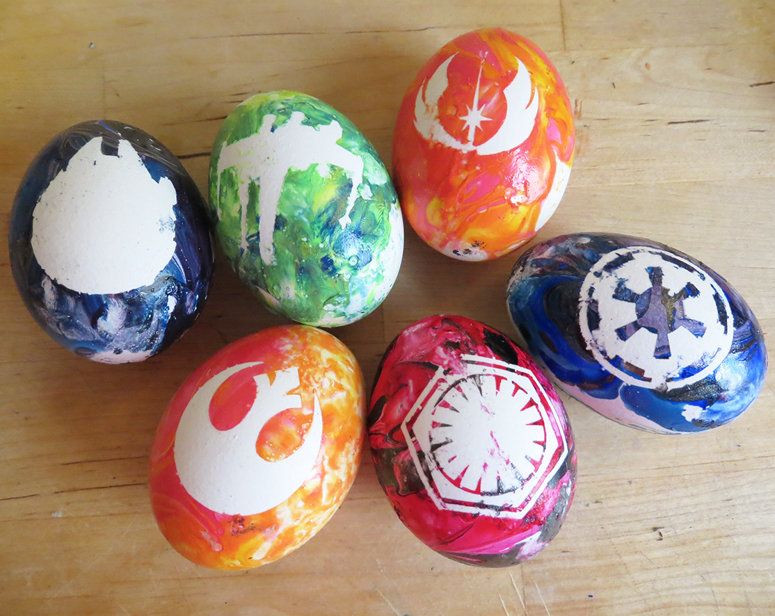 DIY: Star Wars Marbled Easter Eggs - Geekilicious.  Love the idea about vinyl decals, hate that you cant eat them after sooo I would probably use a different coloring method