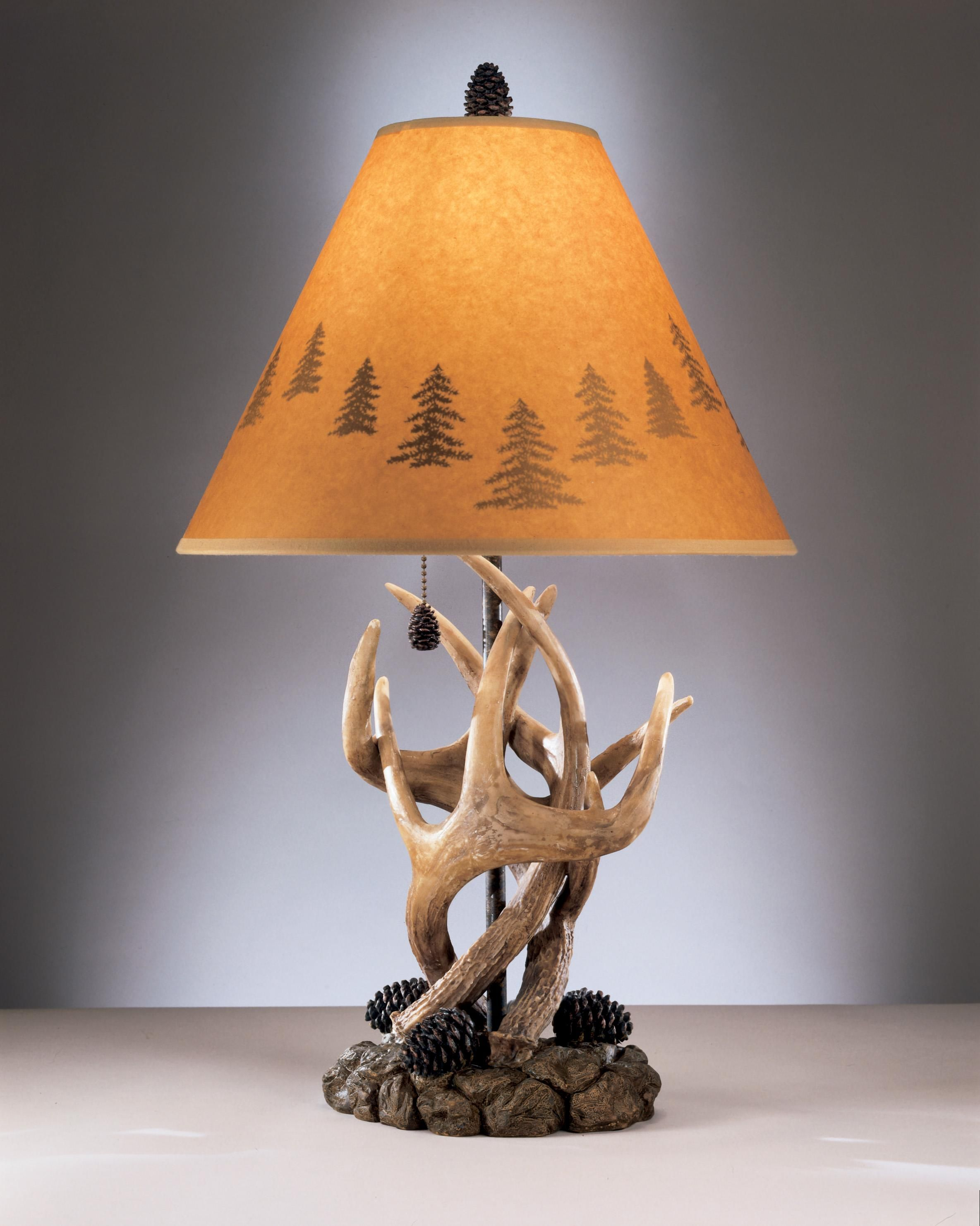 A rustic antlers and pine cone base table lamp topped with a ashley antlers table lamps set of hardback shade onoff switch pull chain type a bulb 100 watts max or 23 watts max cfl onoff pull chain switch geotapseo Images