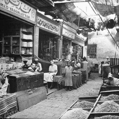 ياميش رمضان والتوابل وكافة مستلزمات العطارة منطقة الحمزاوى بشارع الأزهر Al Azhar Street Old Cairo 1951 Old Egypt Modern Egypt Egypt History