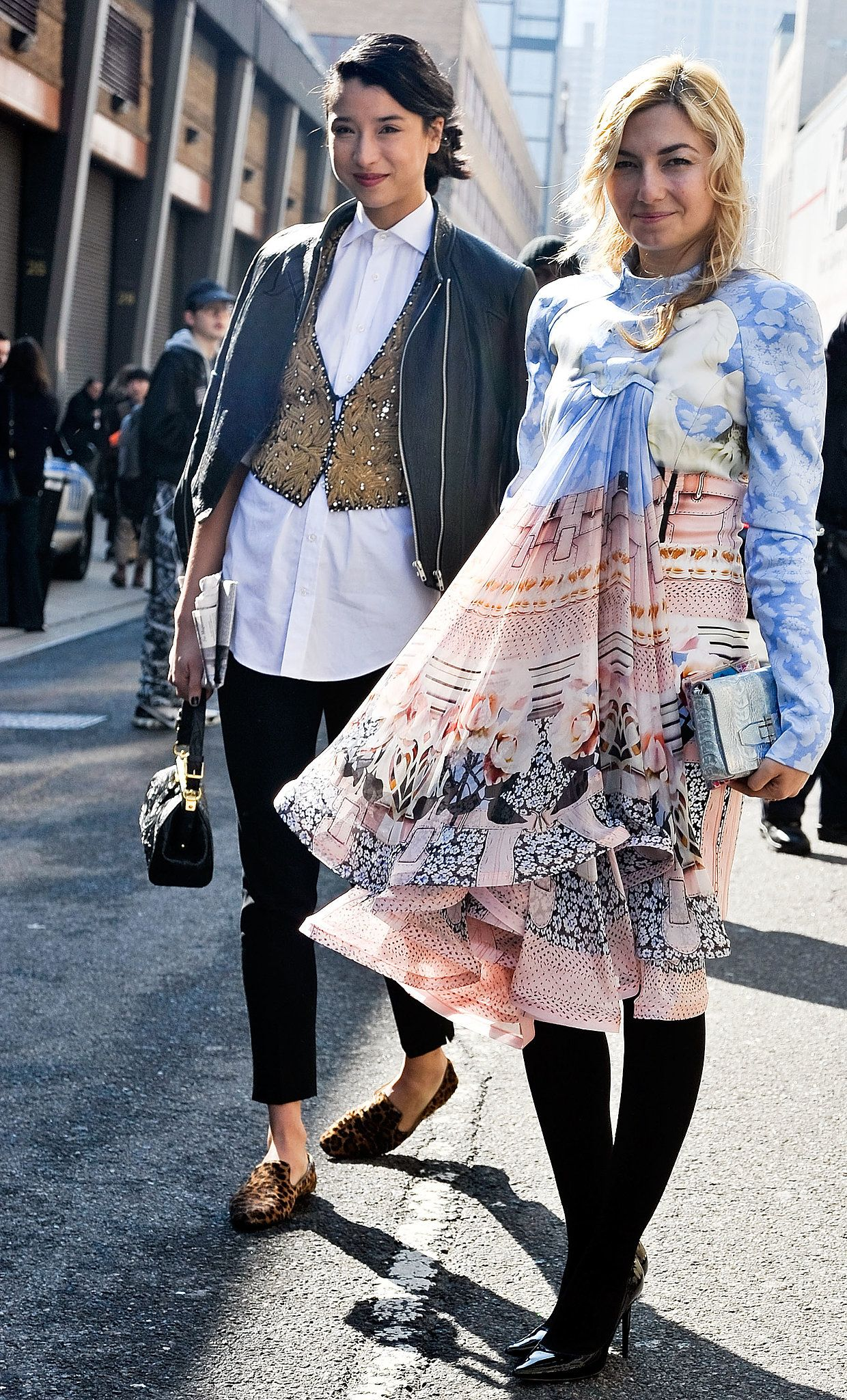 Lily Kwong outfitted a classic white button-down with an embellished vest and loafers, while her fellow show-goer made a statement in a soft, printed babydoll dress.