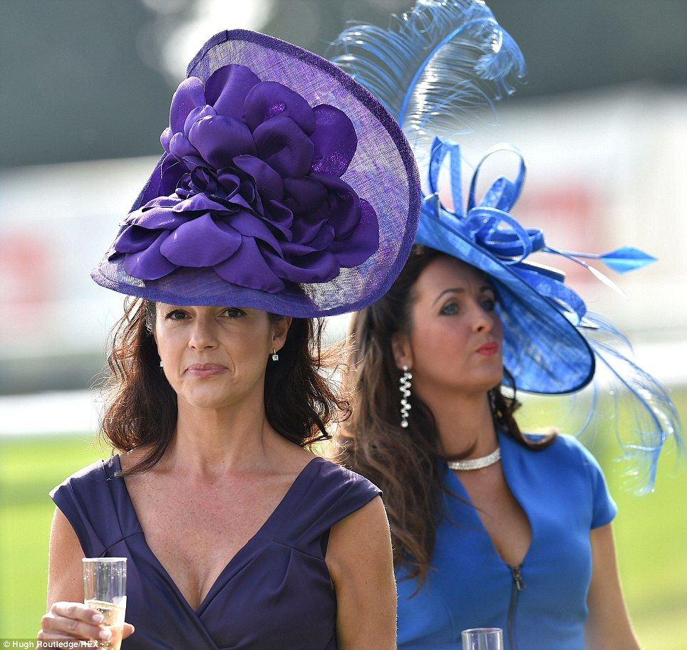 Glamorous Las Sporting Vast Purple And Bright Blue Hats Enjoy A Sunny Gl Of Champagne As They Wait For The Action To Get Underway At Doncaster