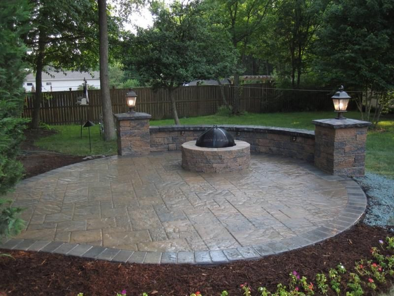 stamped concrete patio with seating walls and fire pit mason ohio