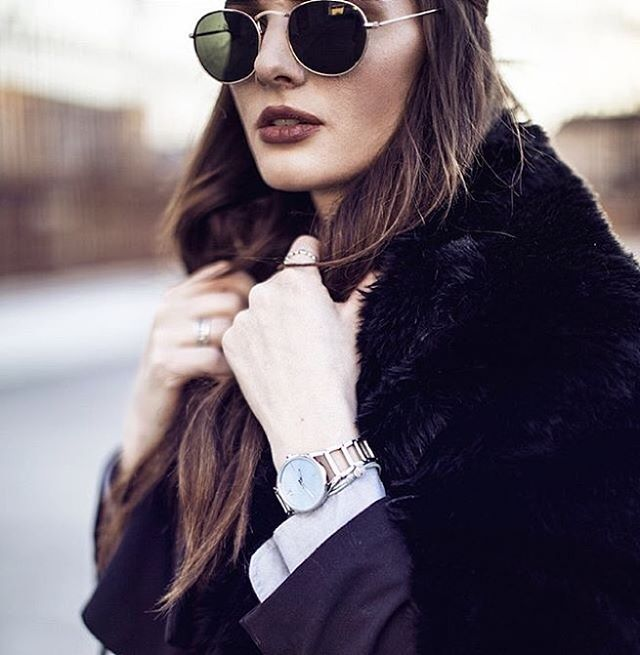 Holiday glow. Blogger Sonja Petrokowsky of Fashion Tweed wears the gold Stately timepiece from Calvin Klein Watches + Jewelry. #ckminute