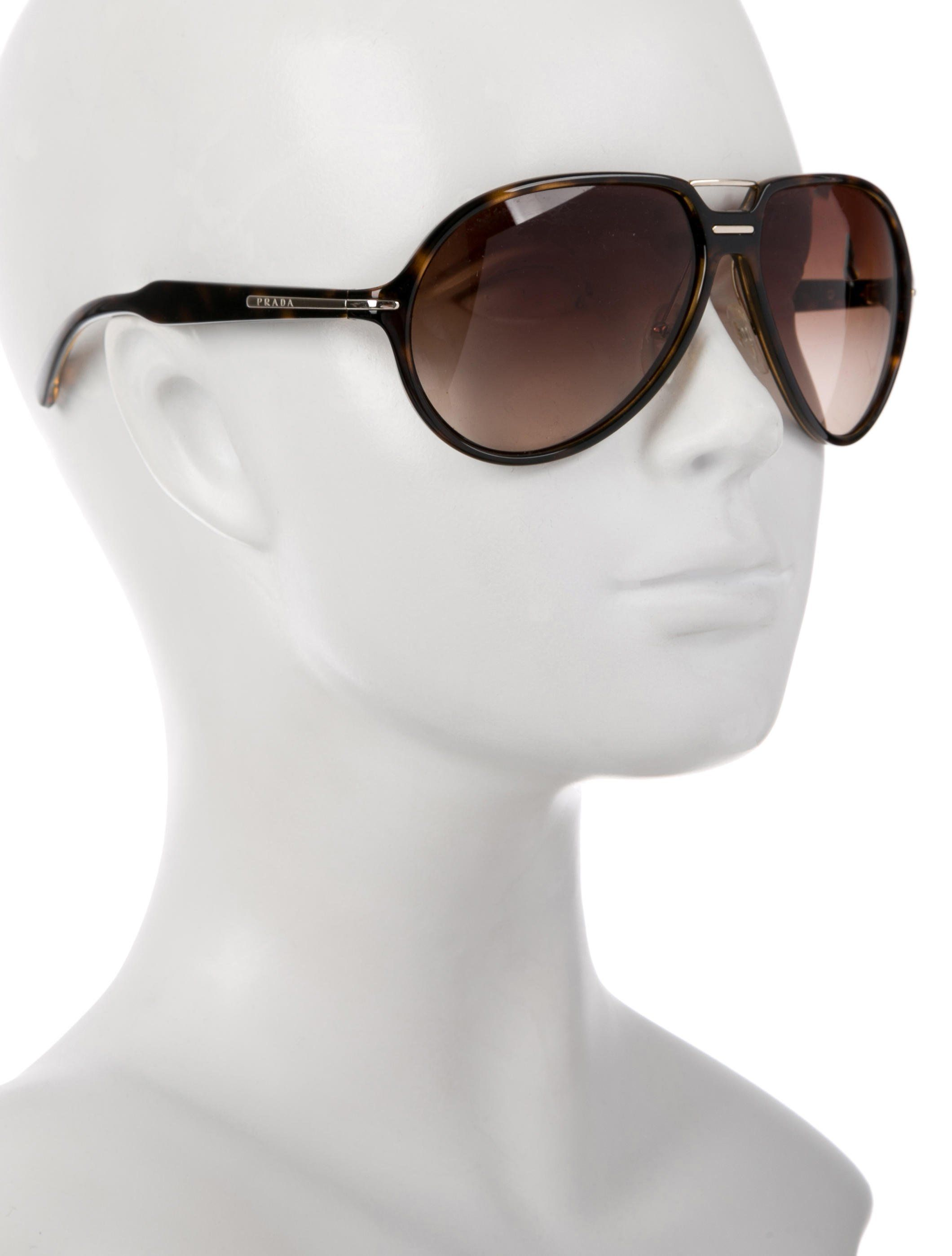503da046fb27 Men's brown acetate Prada aviator sunglasses with round gradient lenses,  top bar, nose pads and logo at temples. Includes case and authenticity card.