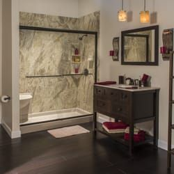 Valencia Granite Shower With Glass Door And Oiled Bronze Fixtures Bathrooms Remodel Shower Surround Home
