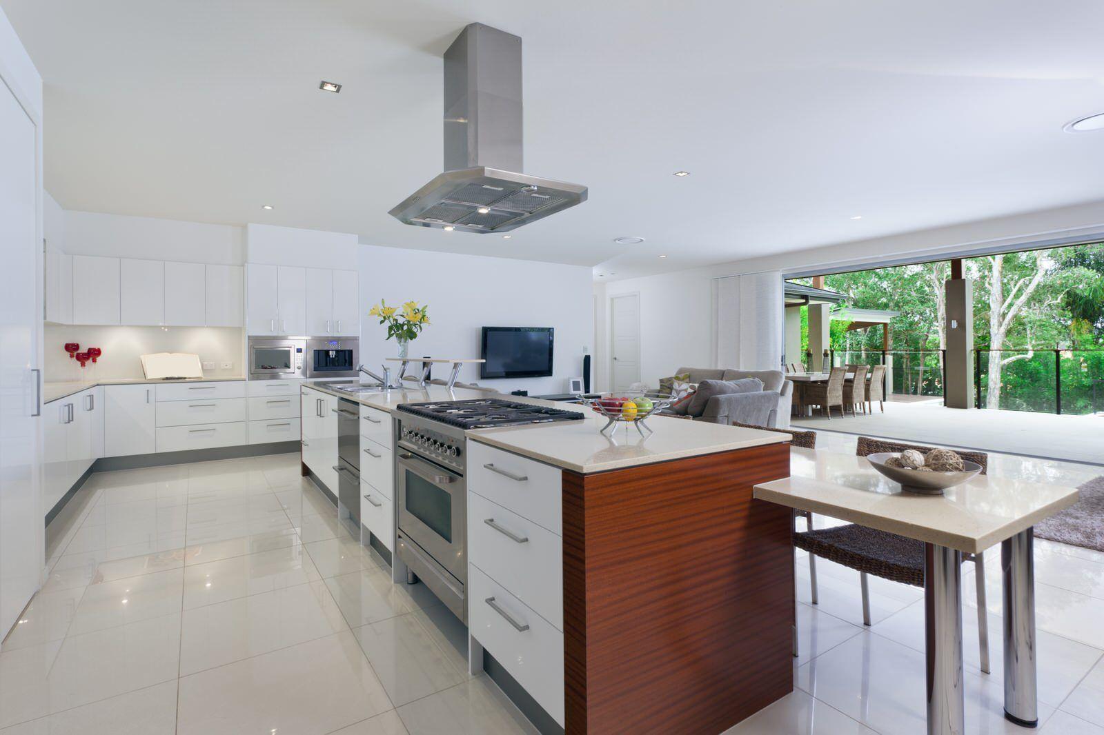 Example of a large minimalist lshaped linoleum floor open concept