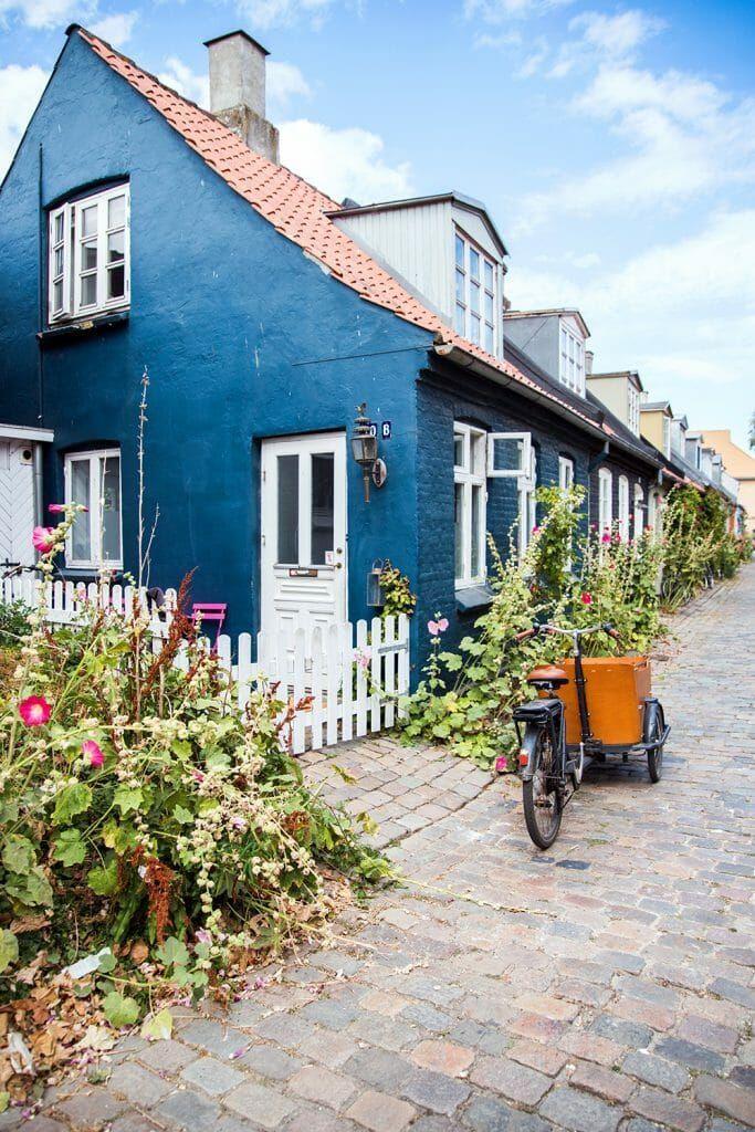 Colorful houses on a cobblestone street in Aarhus, Denmark