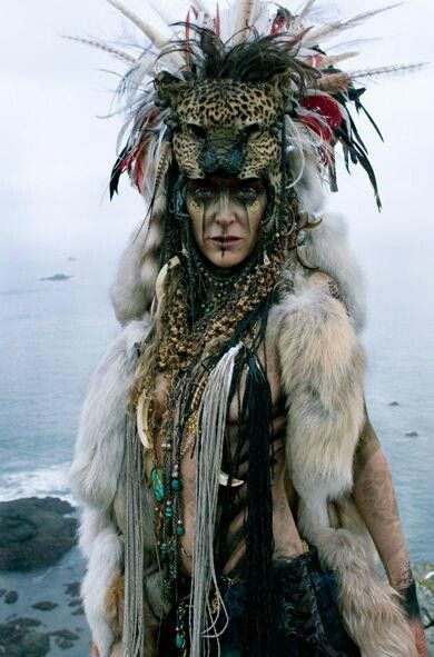 """Warrior goddess,"" female Caucasian shaman in full headgear with furs, amulets, and tattoos or woad"