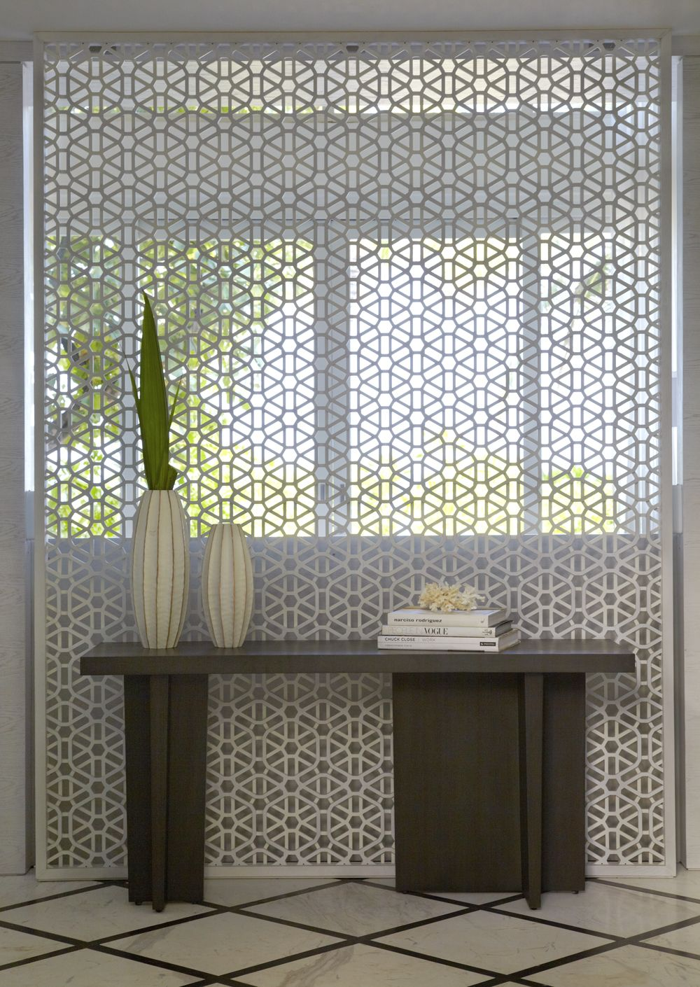 P yabu pushelbergus intricate white screen in the entry at viceroy