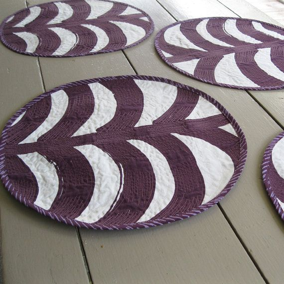 "Add some color and fun to your table setting with this set of four, round purple and off-white Marimekko placemats. The ""Rautaskanky"" print is a striking painted pattern that is machine quilted to add texture and pattern. I used Marimekko ""Sade"" for the placemat backing and binding."