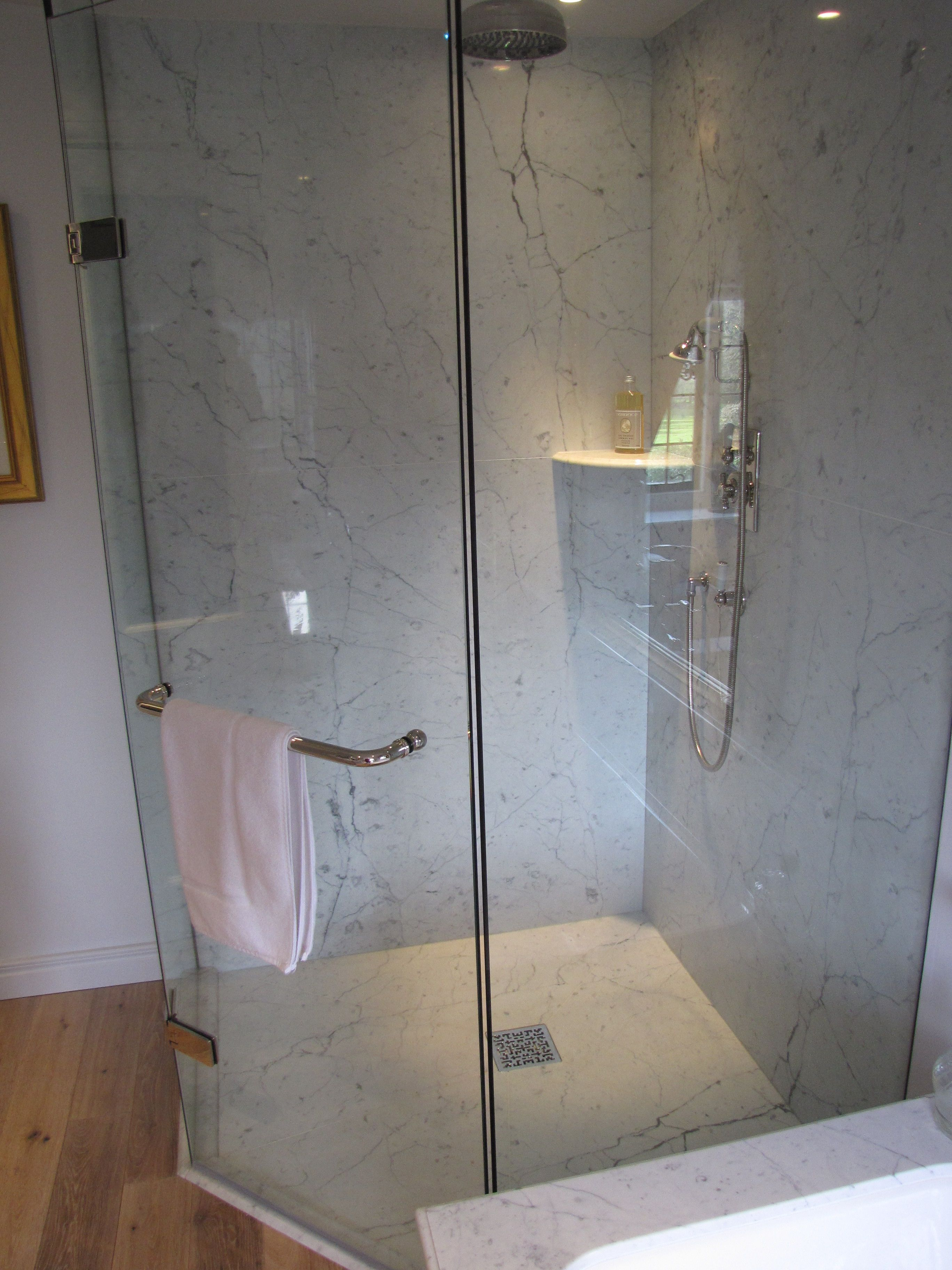 A Beautifully Elegant Marble Shower Crafted Using Book Matched Bianco Carrara