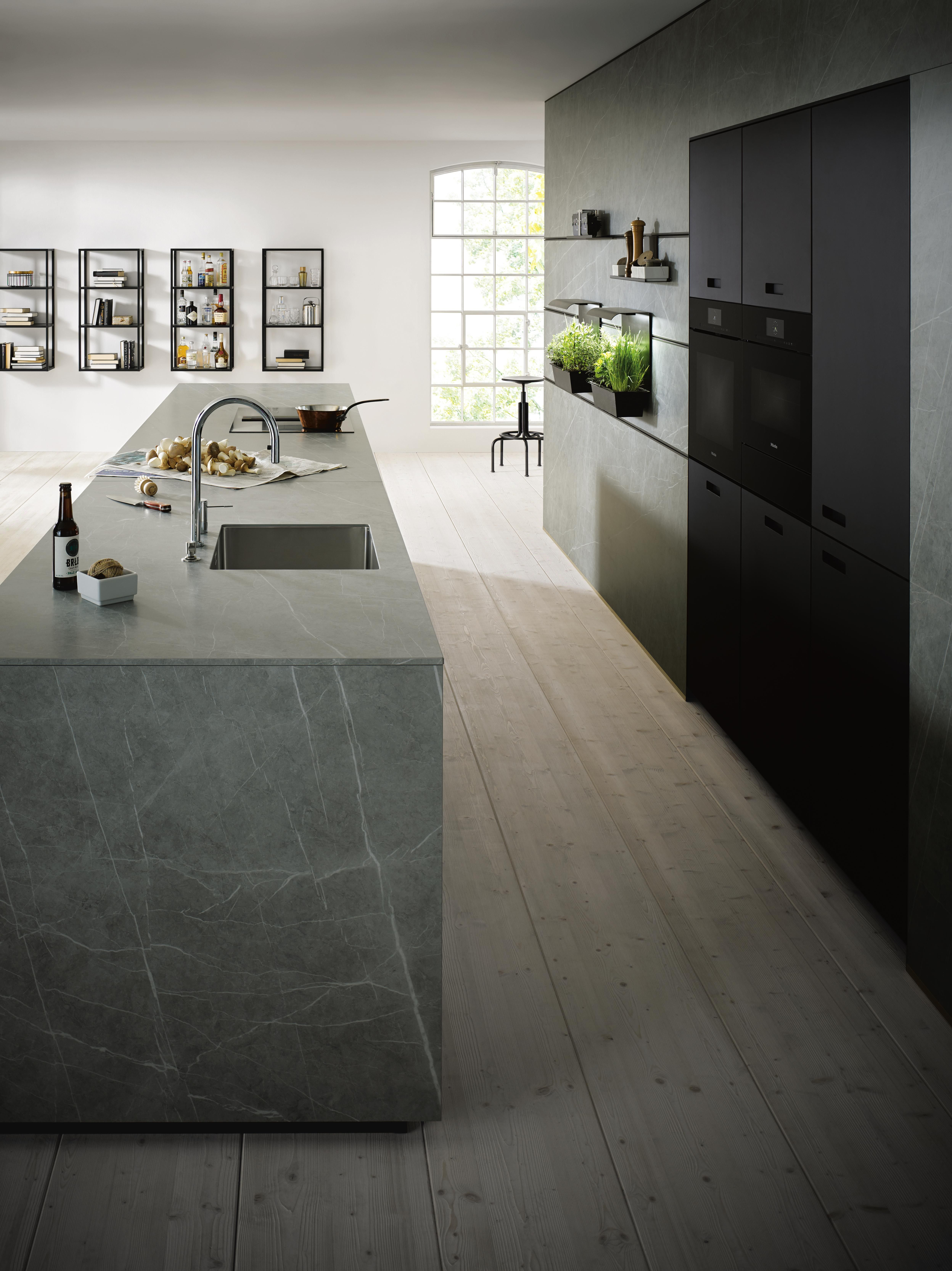 Photo of Modern design kitchen with marble / concrete look island