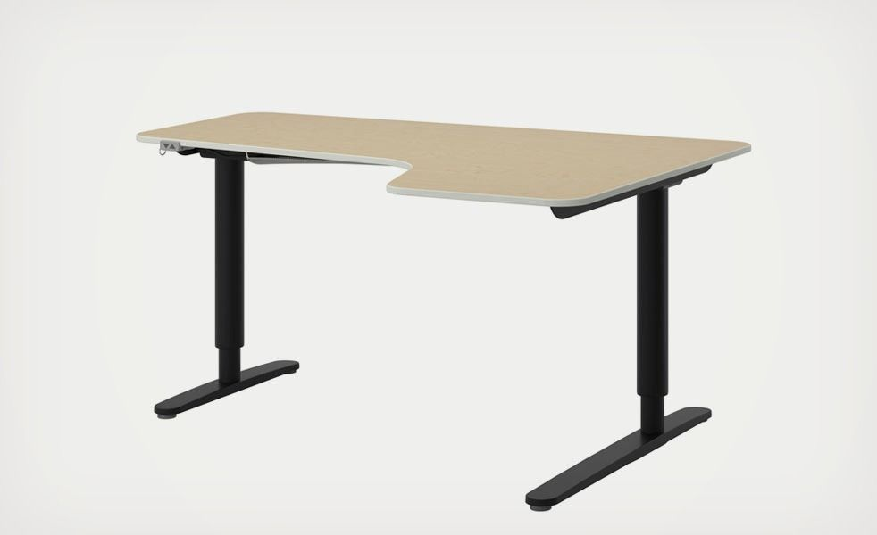 The ikea bekant sit stand desk adjusts with the press of a button
