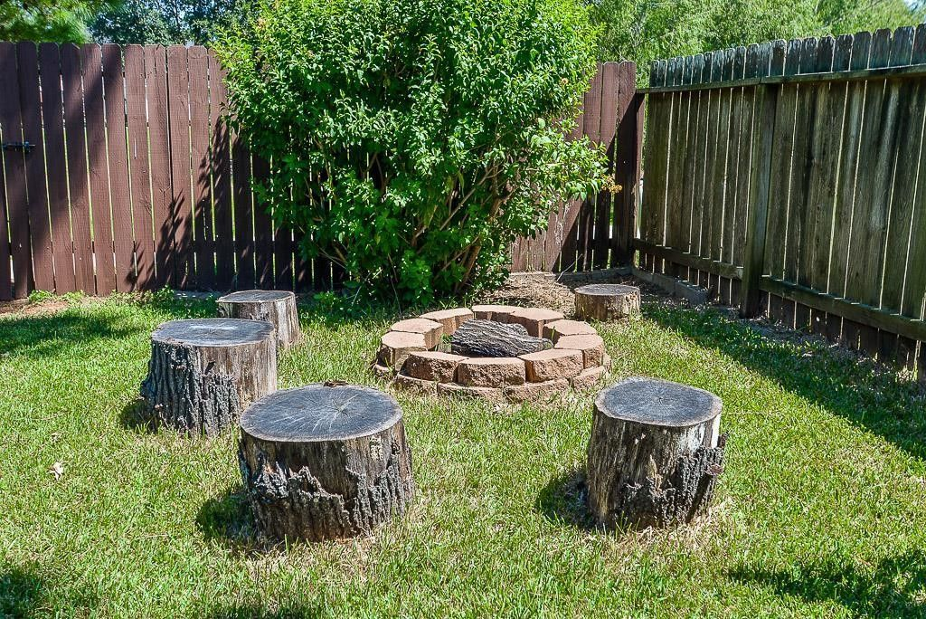 10 Awesome Tree Stump Fire Pit Seating Ideas Go Travels Plan Stump Fire Pit Fire Pit Seating Stone Fire Pit