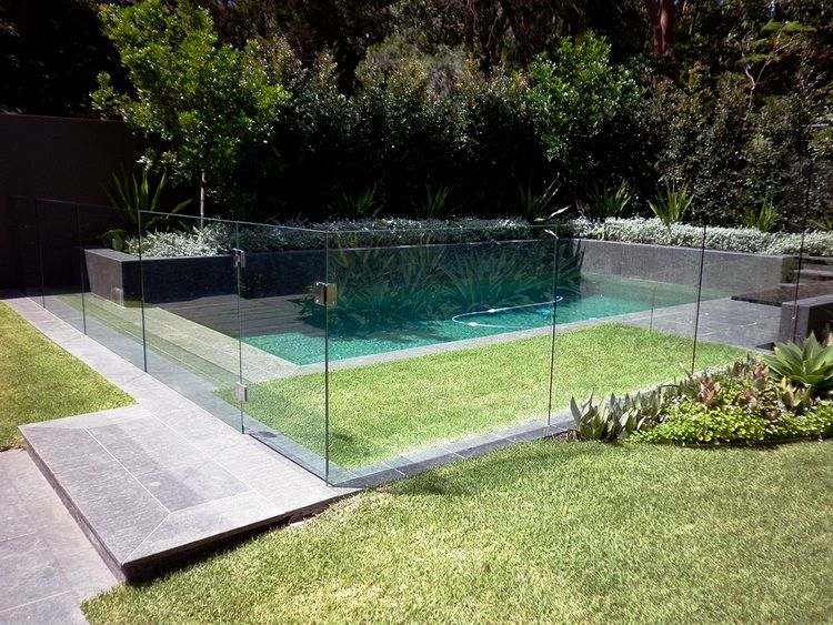 Grass Inside Fence Planting Right Up To Fence Glass Pool Fencing Backyard Pool Pool Landscaping