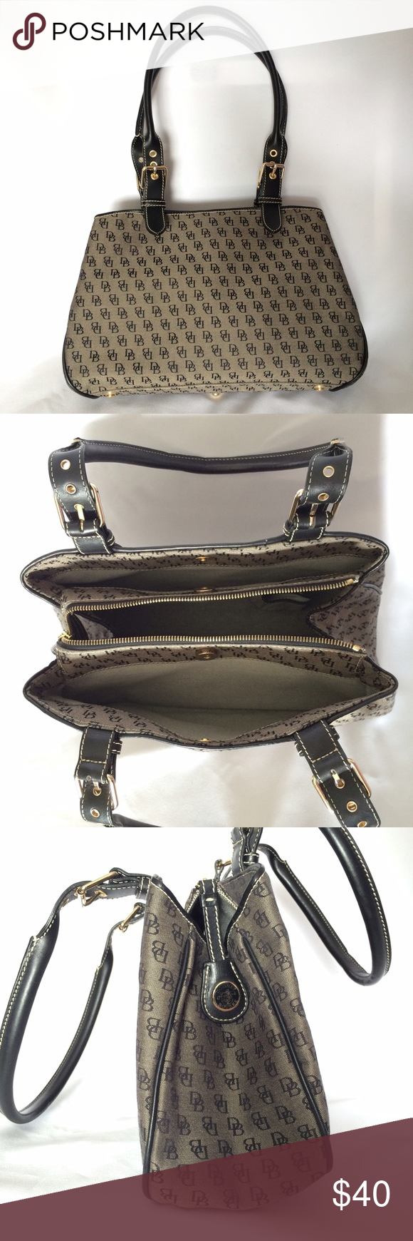 Dooney and Bourke Double Strap Satchel Purse Excellent condition.Only used once. Black/Grey D&B logo canvas. Has 3 compartments: 2 side compartments with magnetic closure; middle compartment zips closed-also has phone pocket. Dooney & Bourke Bags Satchels