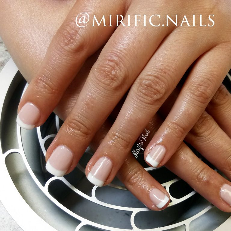 Gel nail polish in pink and white \