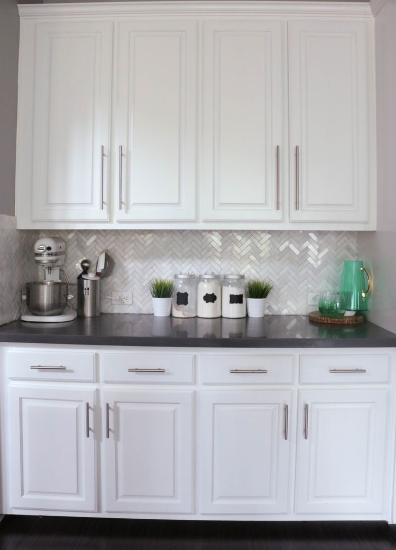 I love the herringbone and the white cabinets and the pops of teal ...