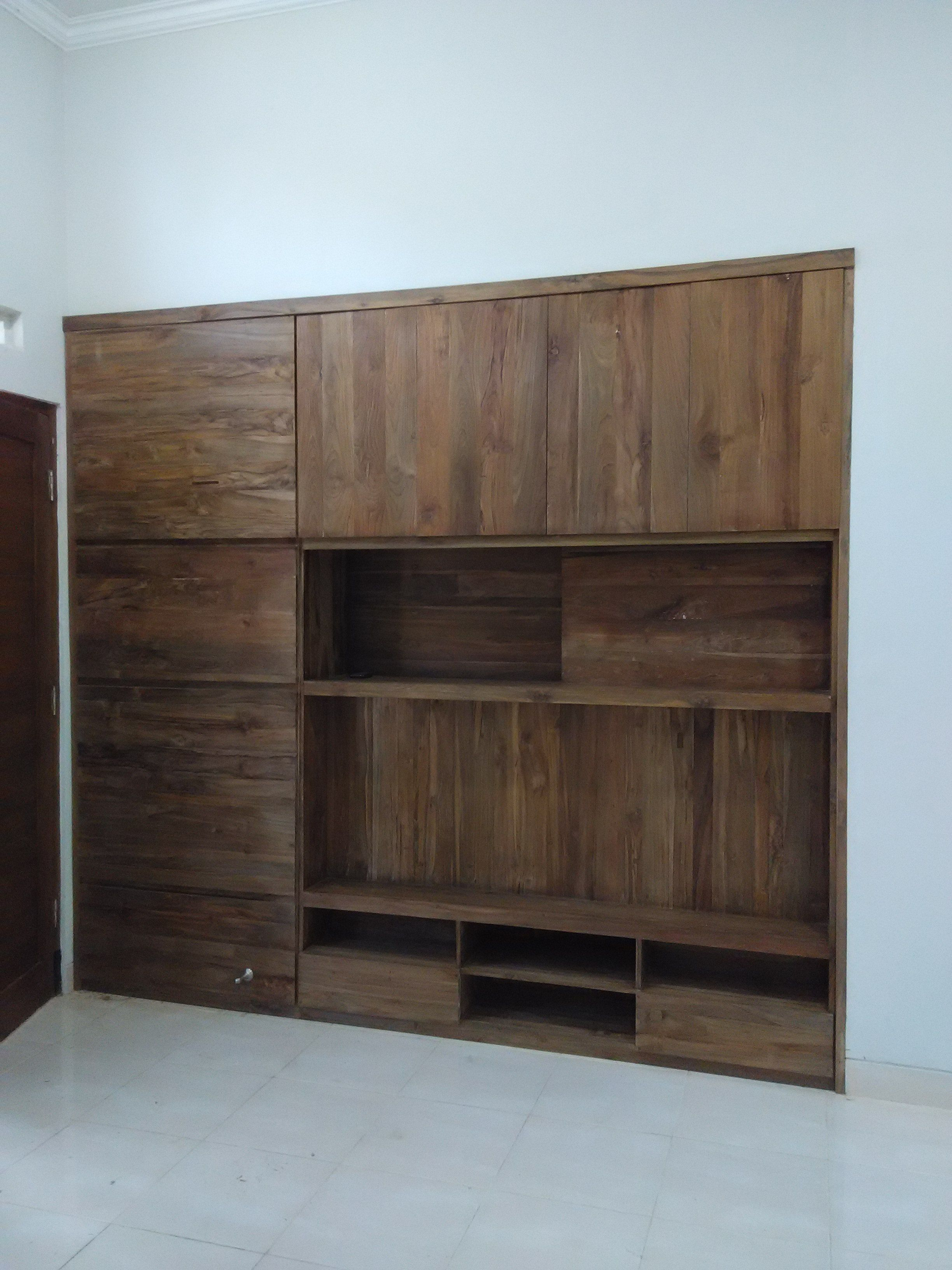 Built in tv cabinet as a room divider for saving space furniture
