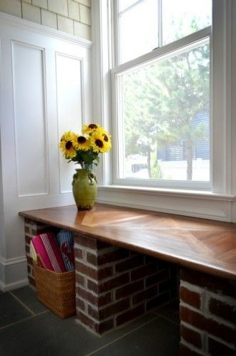 Mudroom: Here it's been designed to look like a converted porch, finished with exterior siding, a brick bench, and a slate floor.