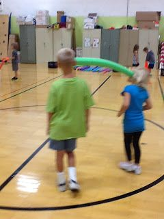 This is a great activity because not only does it build gross motor development but communication and teamwork as well.