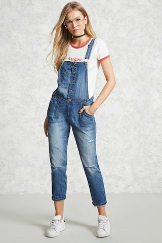 eb93a446a258 A pair of distressed denim overalls featuring a button front