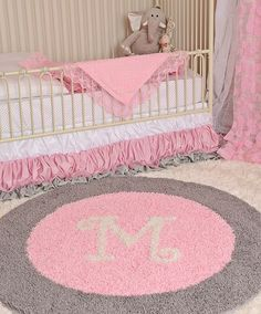 pink and gray nursery design - love the personalized rug