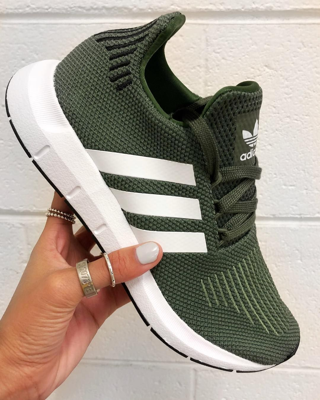 25c85853b adidas Originals Swift Run – Green – AQ0866 - Shoes. Stylish adidas shoes  displayed by woman with jewellery.