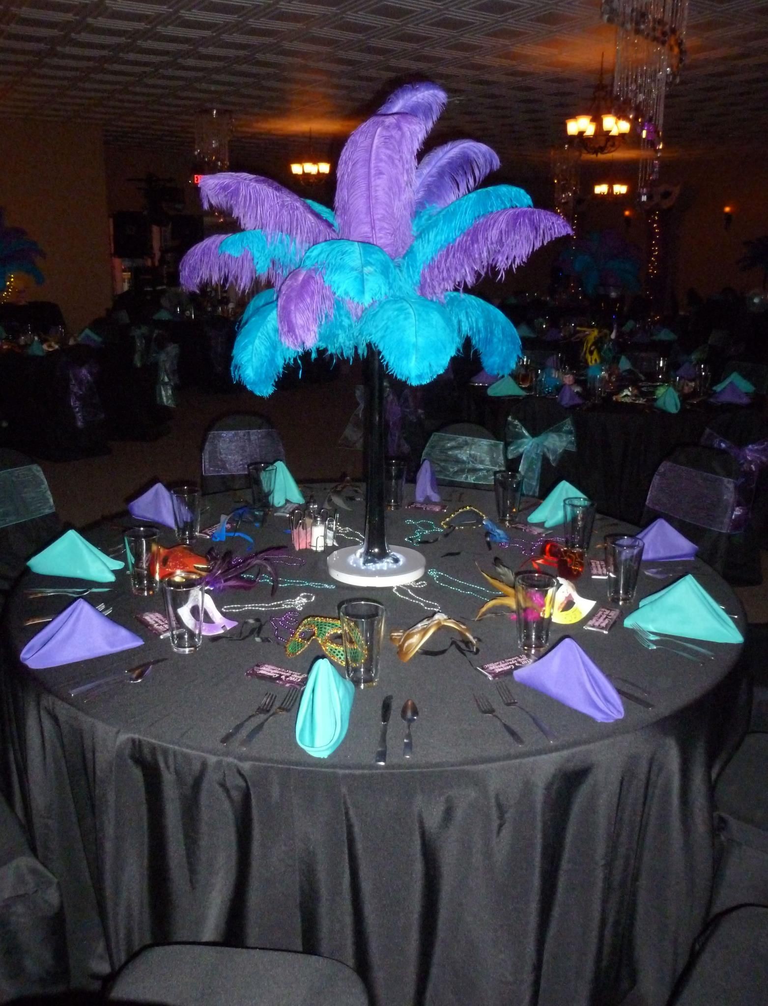 Tall center piece with feathers... but the bottom needs something ...