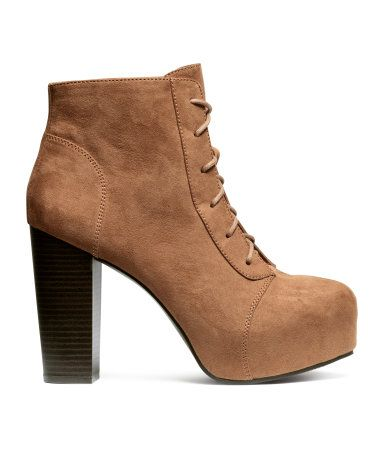 7e3d3123f7f Lace-up ankle boots with platform heel in a soft caramel color suede-like  material.