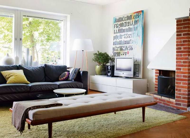 InteriorInexpensive Living Room Apartment Decorating Ideas With Unique Brick Fireplace And Black Leather Sofa Featuring Simple Ottoman White Cabinet TV