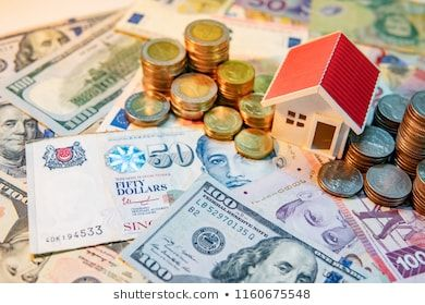 Real estate or property investment Home mortgage loan rate Saving money for retirement Coin stack on various of international banknotes with house model on table Business...