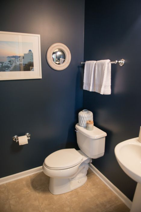Deep rich navy walls in naval sw 6244 white accents with for Bathroom ideas navy blue