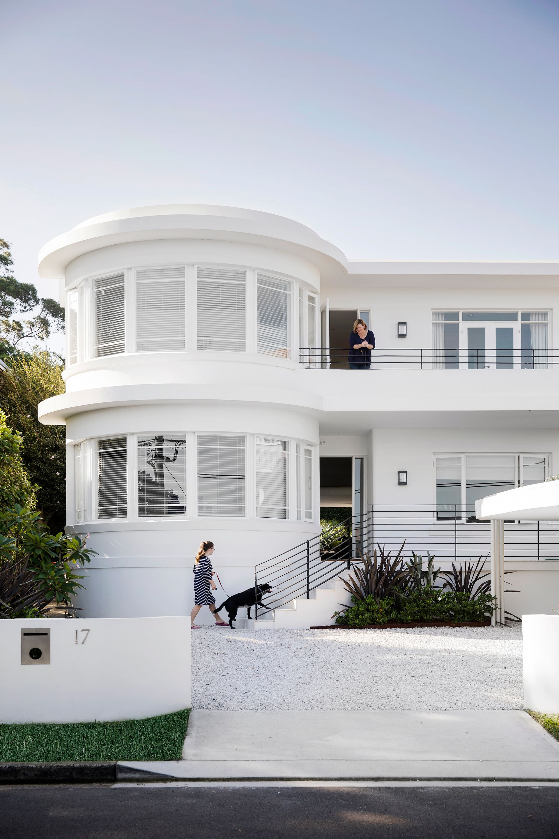 Exterior shot of a renovated white art deco style home on sydneys lower north shore photography chris warnes styling kayla gex