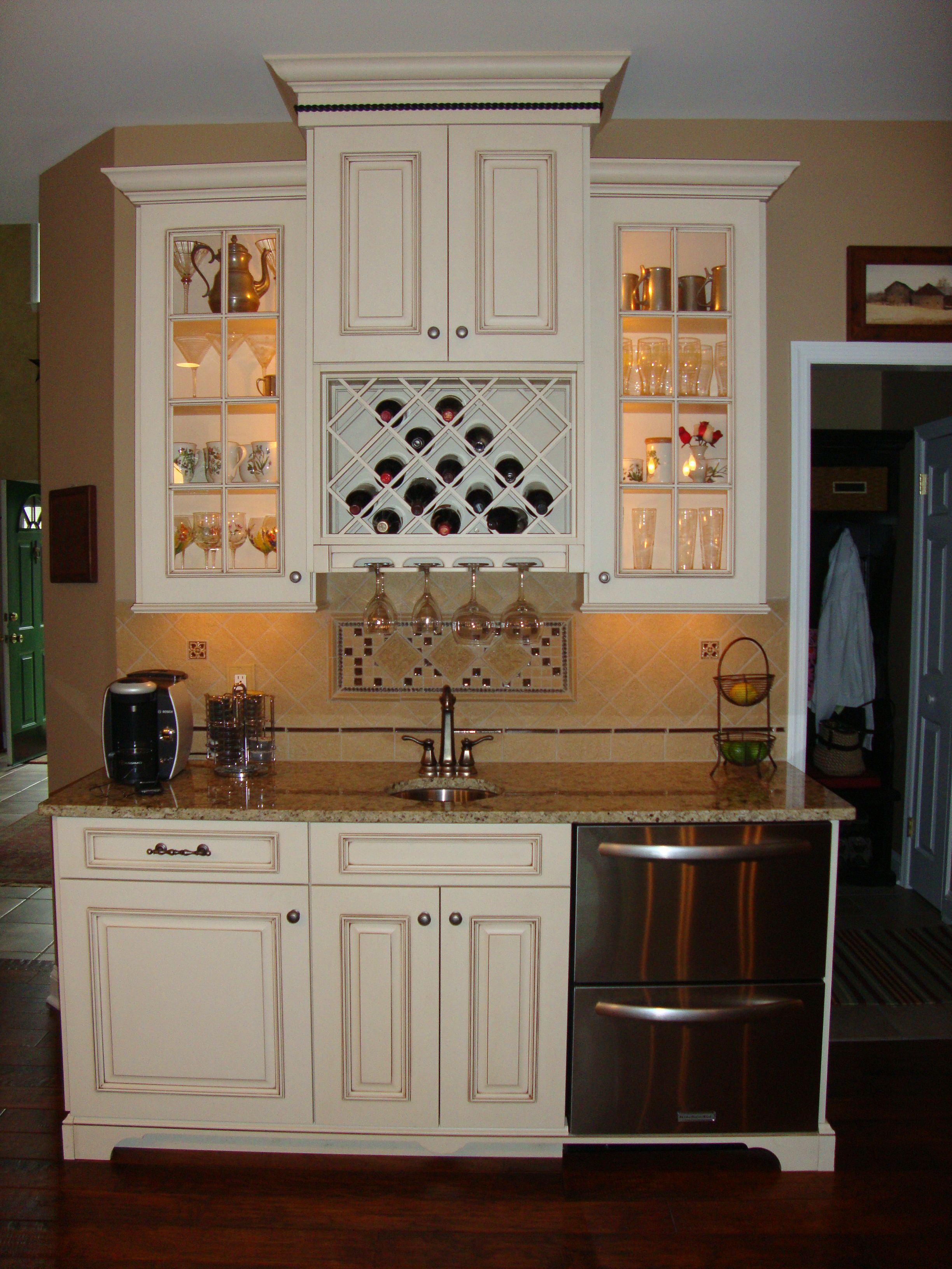 Cute built in wine rack and glass light up cabinets but i - Kitchen built in cupboards designs ...