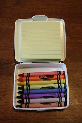 Travel coloring kit - crayons, post-its, empty travel first aid ...