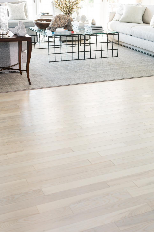 The Living Room S Light Wood Floor Has A Coastal Feel With The