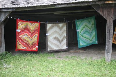 Spinner Knits : Pioneer Village Quilt Show 2013  The bargello quilts from a class were all hung together.  It's amazing how different each one looks even though they are made from the same pattern!