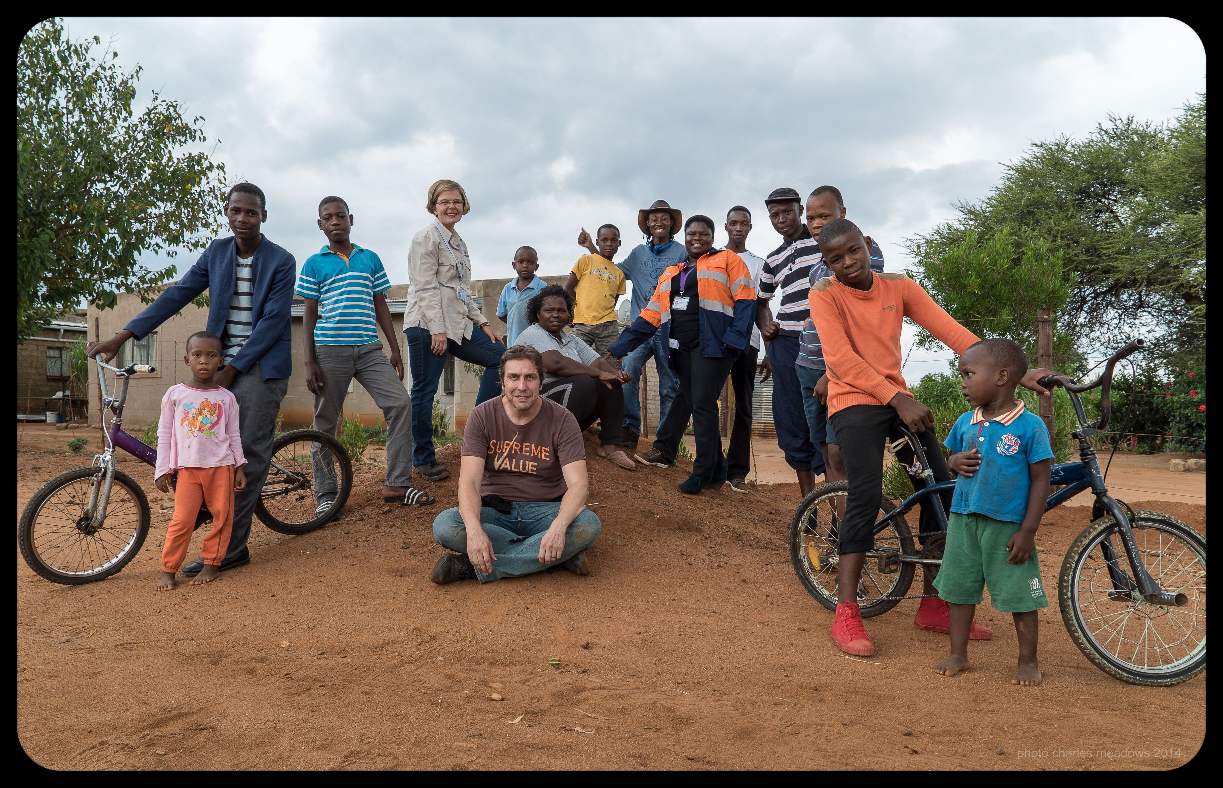 After the final shot for an Ivanplats corporate video (in Limpopo South Africa) we noticed that quite a few kids from the community had gathered around to watch us. Seemed like a great opportunity to get a picture of us all together.
