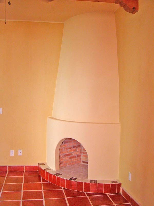 Traditional Adobe Kiva Fireplace Brings Warmth To The Earthen Home Corner Fireplace Outdoor Oven Southwestern Style