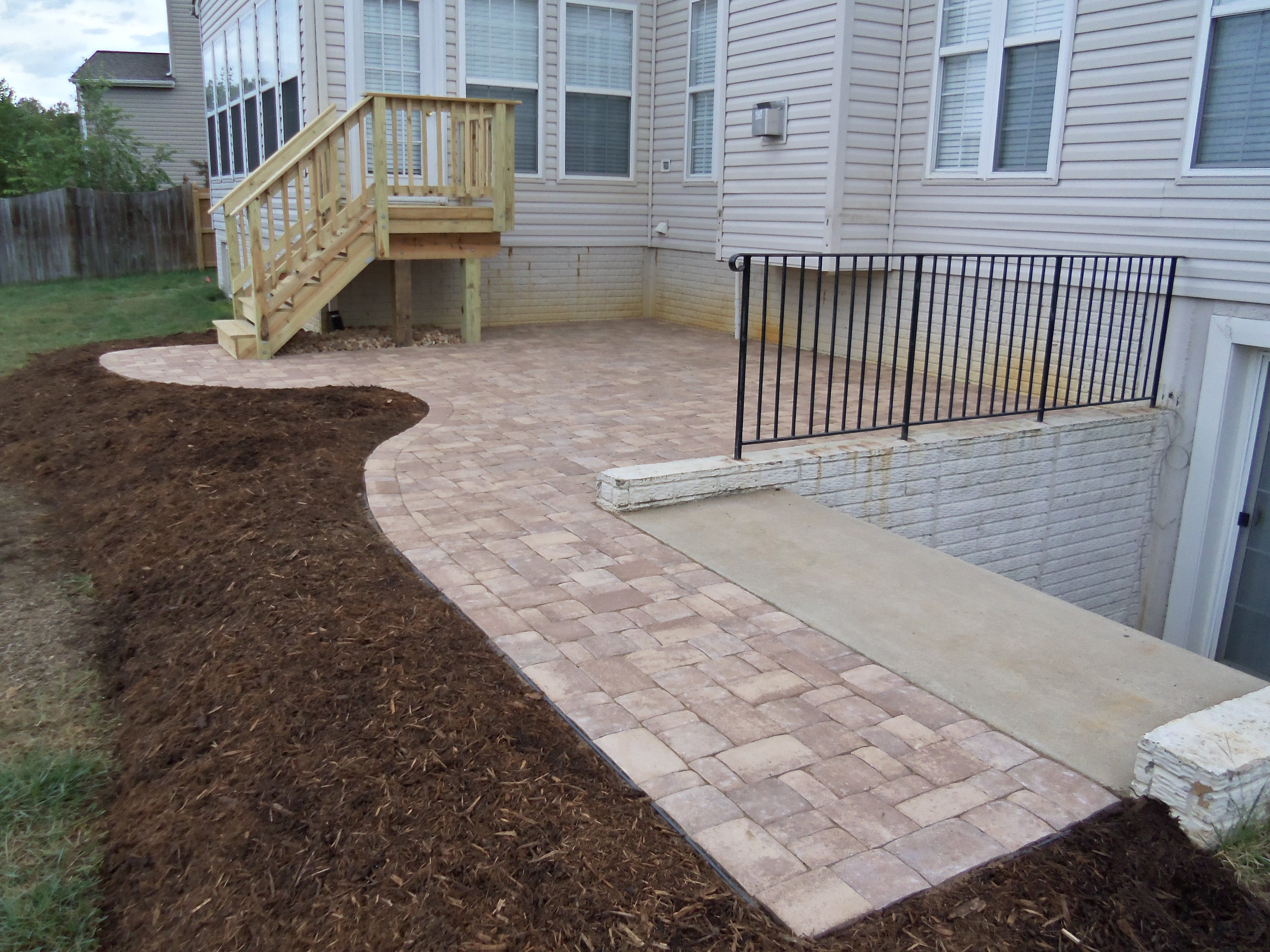 I really like the large paver patio connecting the staircase from