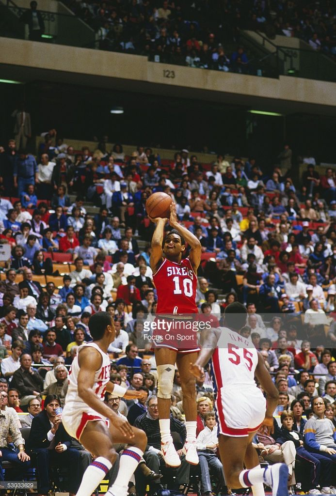 Philadelphia 76ers  Maurice Cheeks  10 makes a jumpshot against the New  York Nets during the playoffs at Meadowlands Arena circa 1984 in East  Rutherford 75be8742f