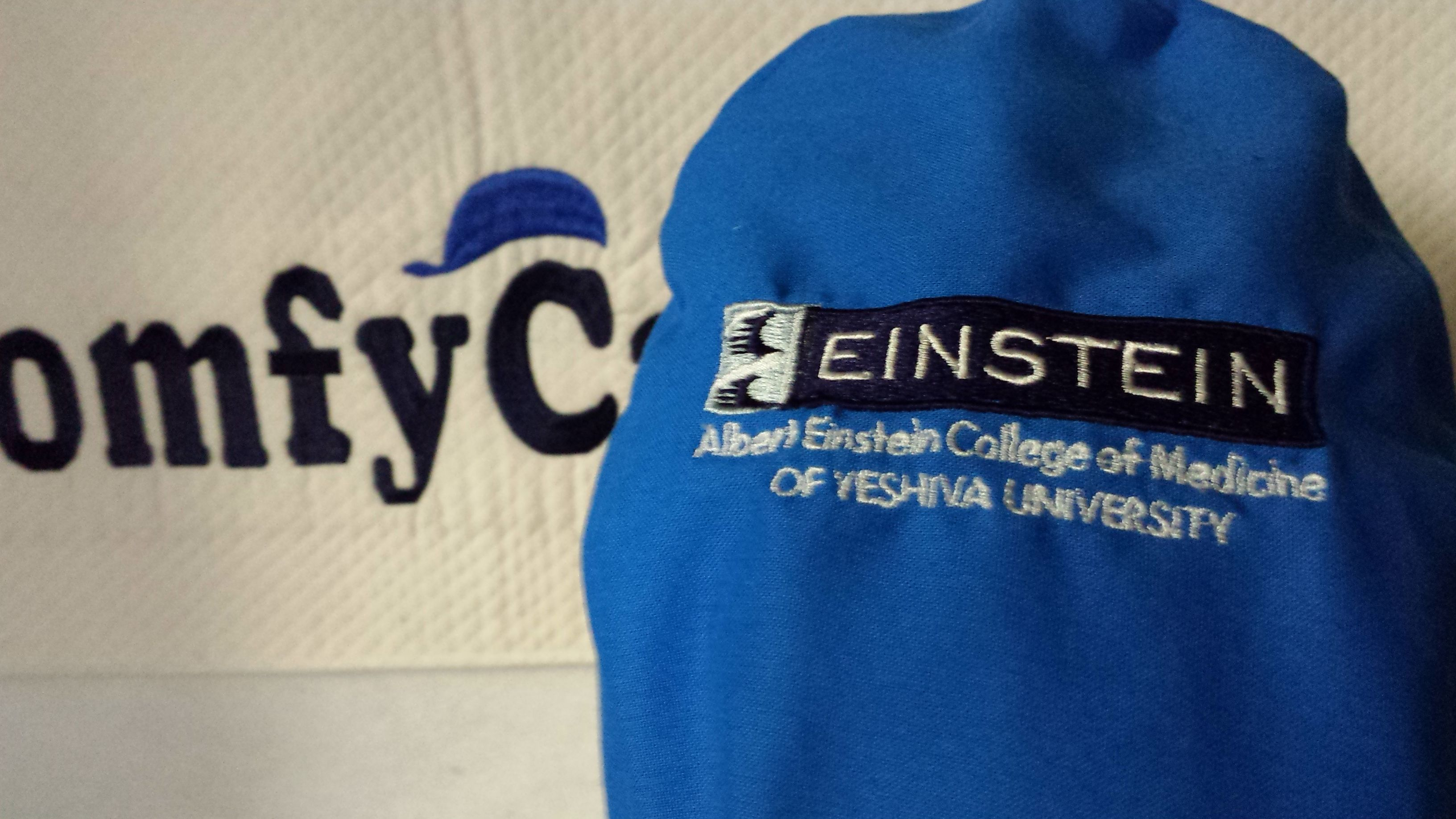 Albert Einstein College of Medicine logo embroidered on the top part of a  male scrub cap