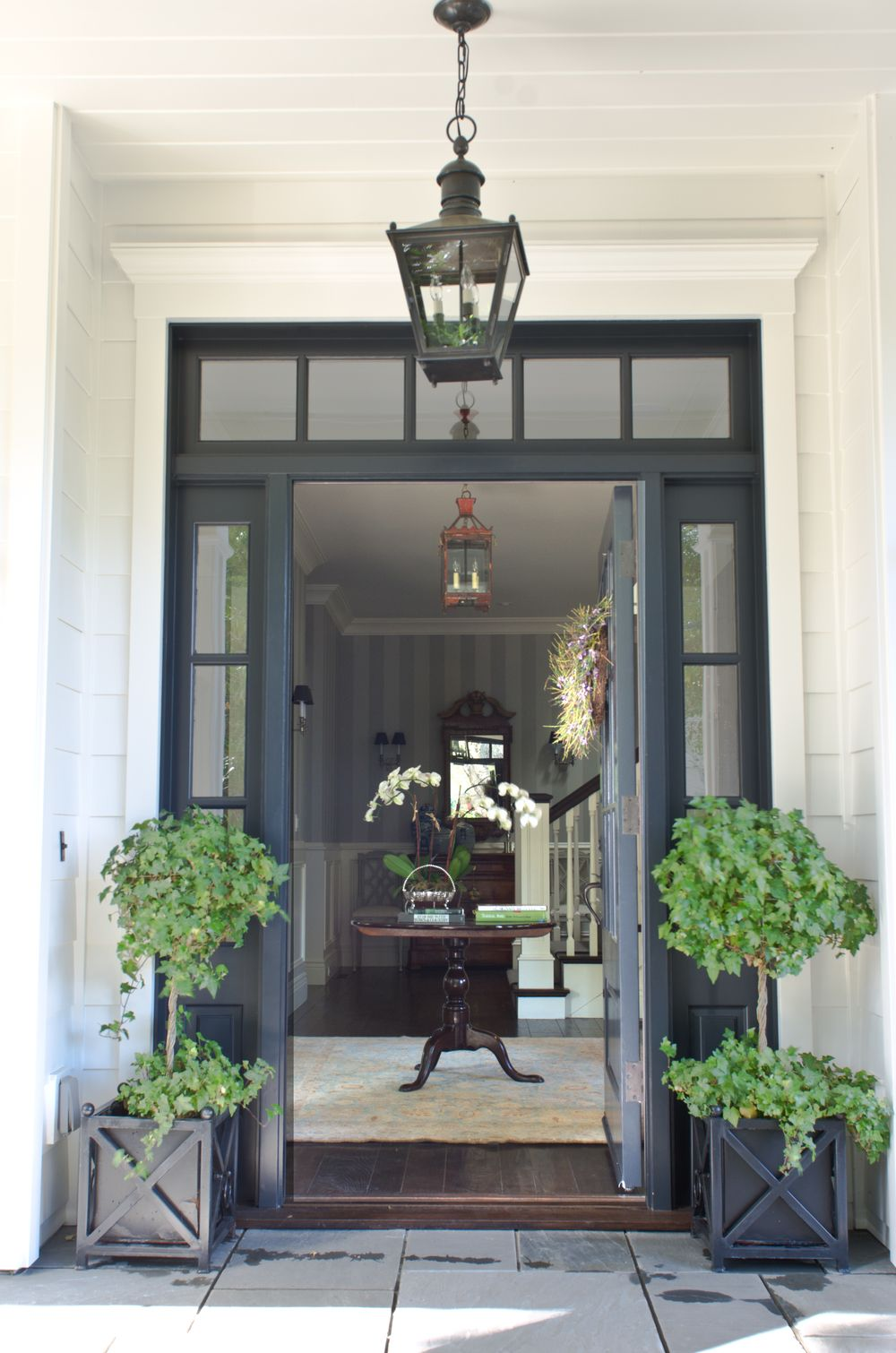 Beautiful Front Door Entryway With Symmetrical Glass Paneling And