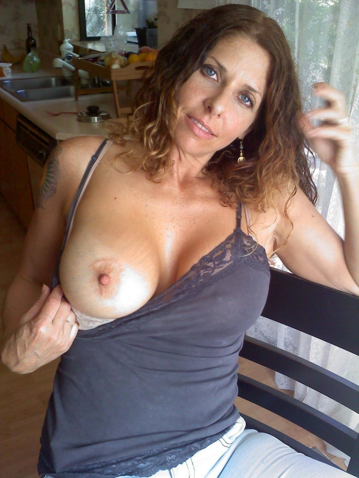 milf flashing boobs