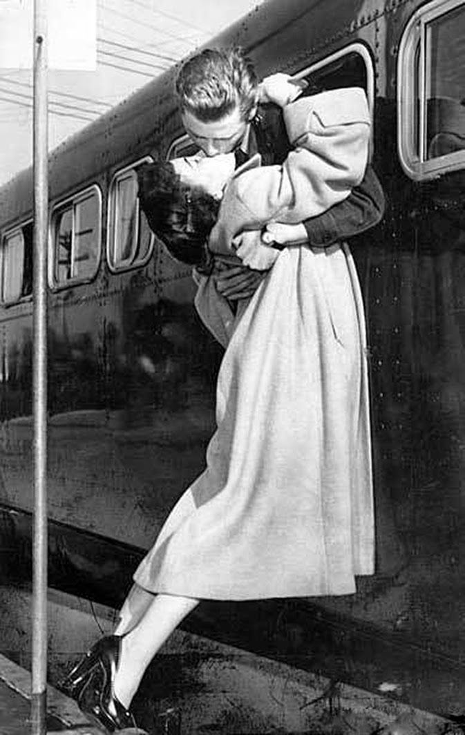 Sgt. 1st Class Owen Marsh of North Hollywood leans out a bus window to pick up his wife, Evelyn, for a kiss before going to Ft. MacArthur, where he was discharged, 1952.